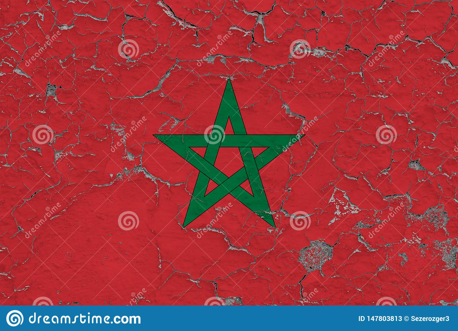 Flag of Morocco painted on cracked dirty wall. National pattern on vintage style surface