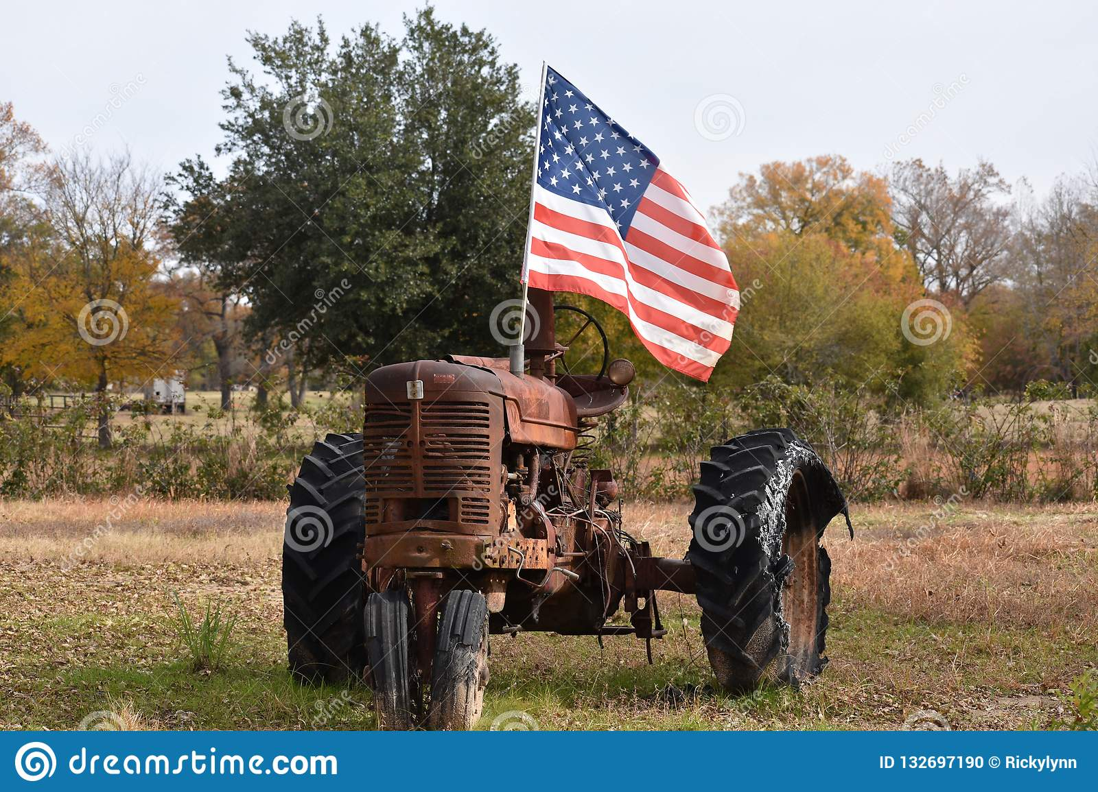 Flag And Old Tractor In Gilmer Texas Nov 25 2018 Stock Photo