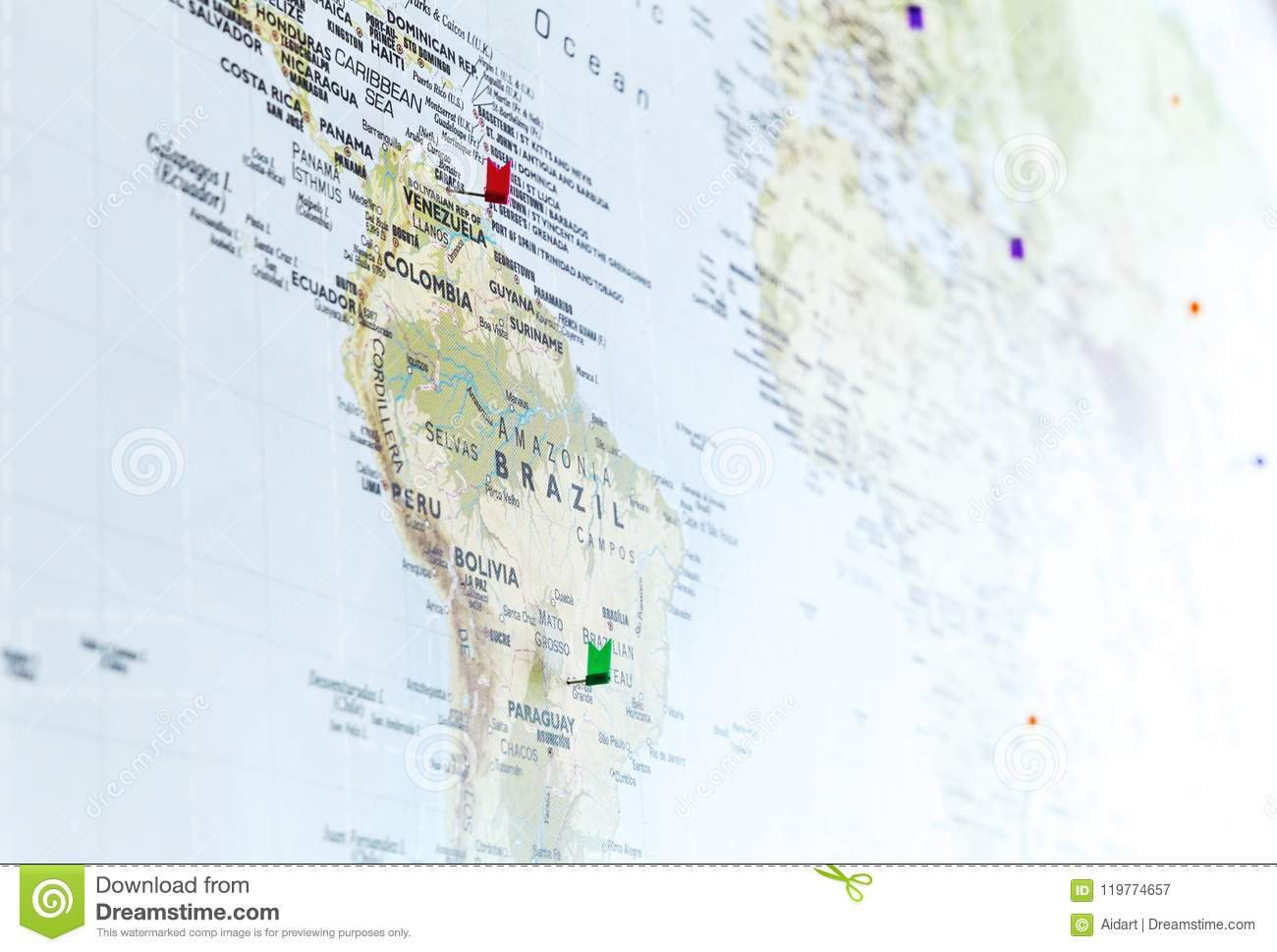 flag pins on world map with focus on south america stock image