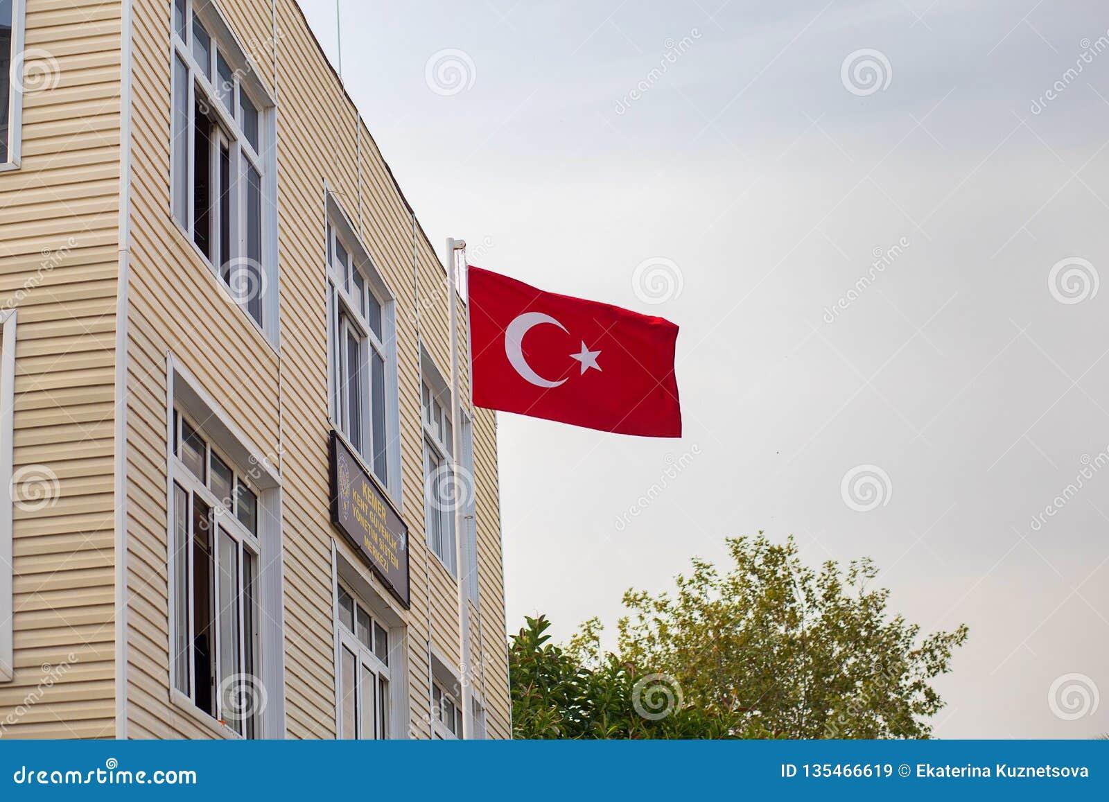 The flag of Turkey develops on wind