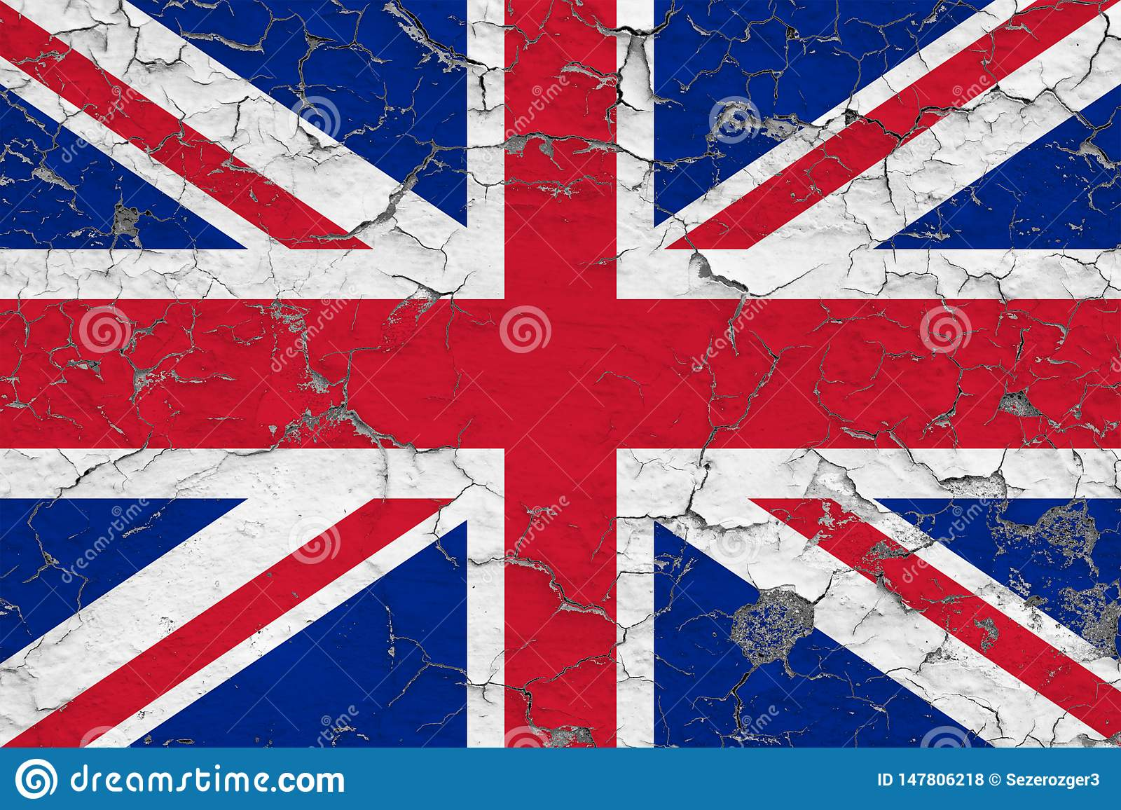 Flag of United Kingdom painted on cracked dirty wall. National pattern on vintage style surface