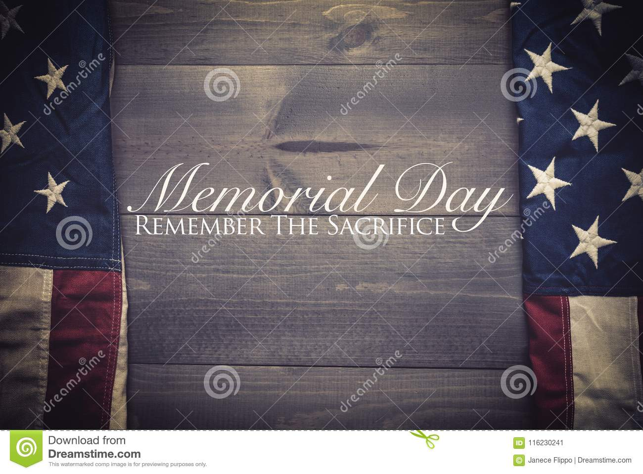 The flag of the United Sates on a grey plank background with memorial day