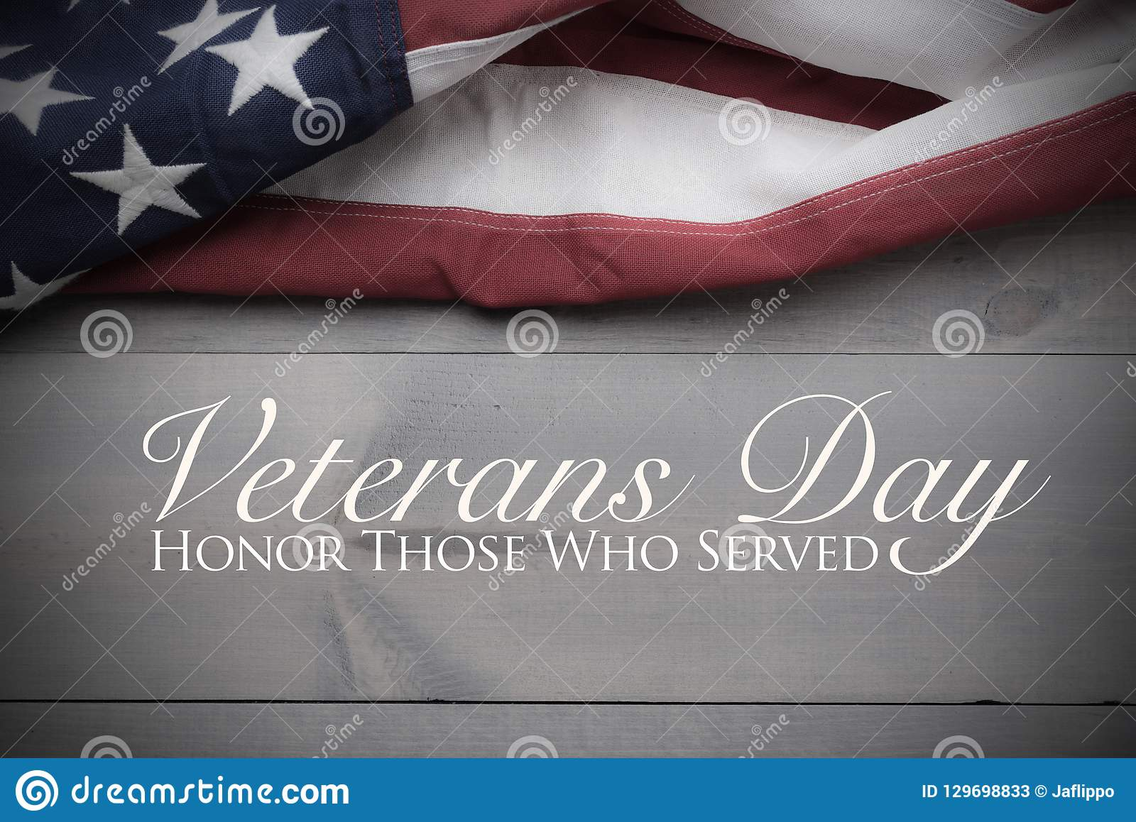 The flag of the United Sates on a grey plank background with copy space Veterans Day tribute