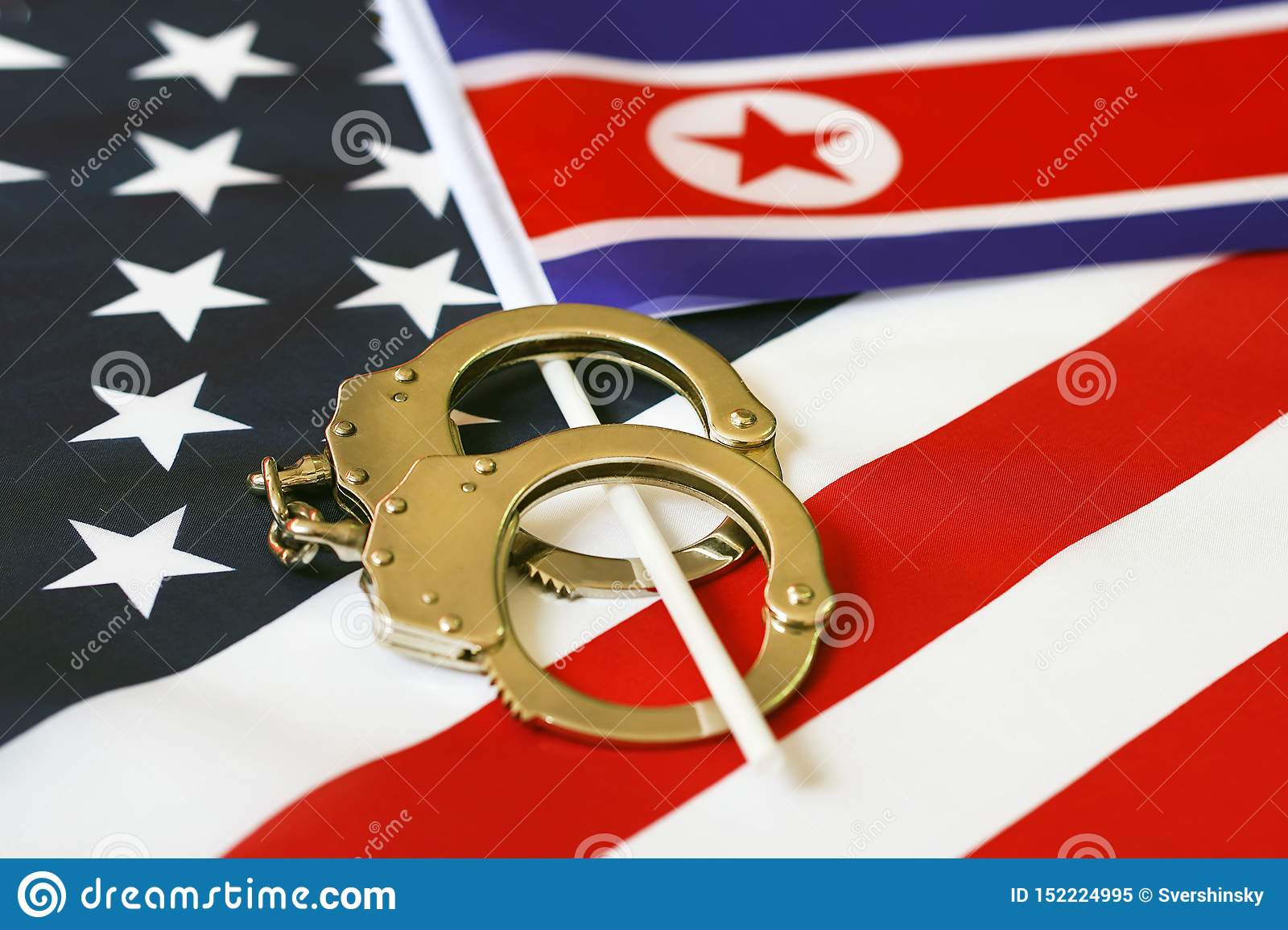 Flag of USA and North Korea. Handcuffs. Sanctions