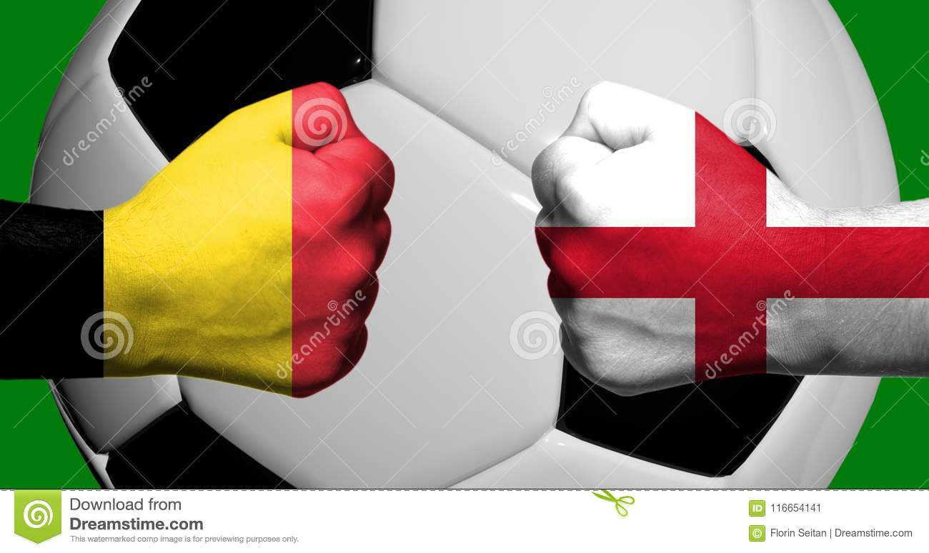 Flags of Belgium and England painted on two clenched fists facing each other with closeup 3d soccer ball in the background/Soccer