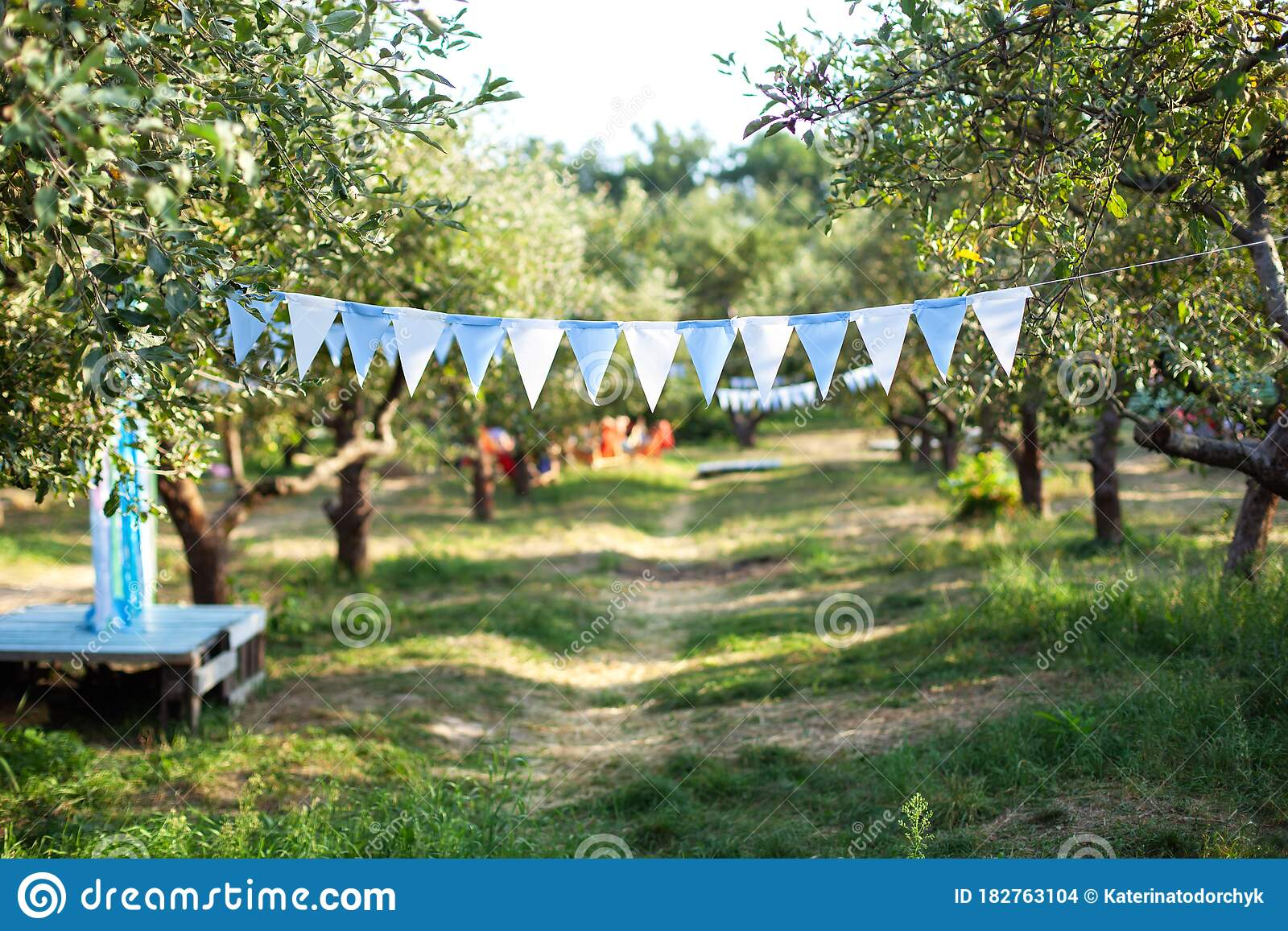 Flags Birthday Decorations Hanging On Tree Branch In Garden Colorful Bunting Flags Hanging In Park Garden Party Decoration Wedd Stock Photo Image Of Event Flags 182763104