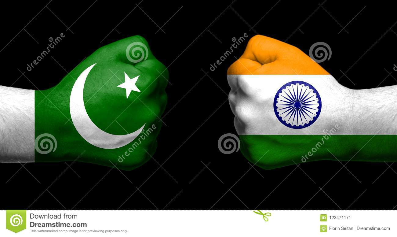 Flags of India and Pakistan painted on two clenched fists facing