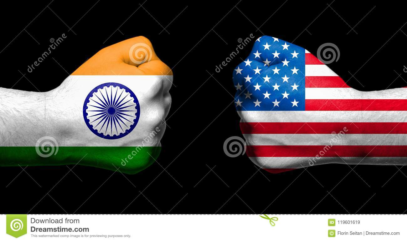 Flags of India and United States painted on two clenched fists facing each other on black background/India - USA tariff conflict c