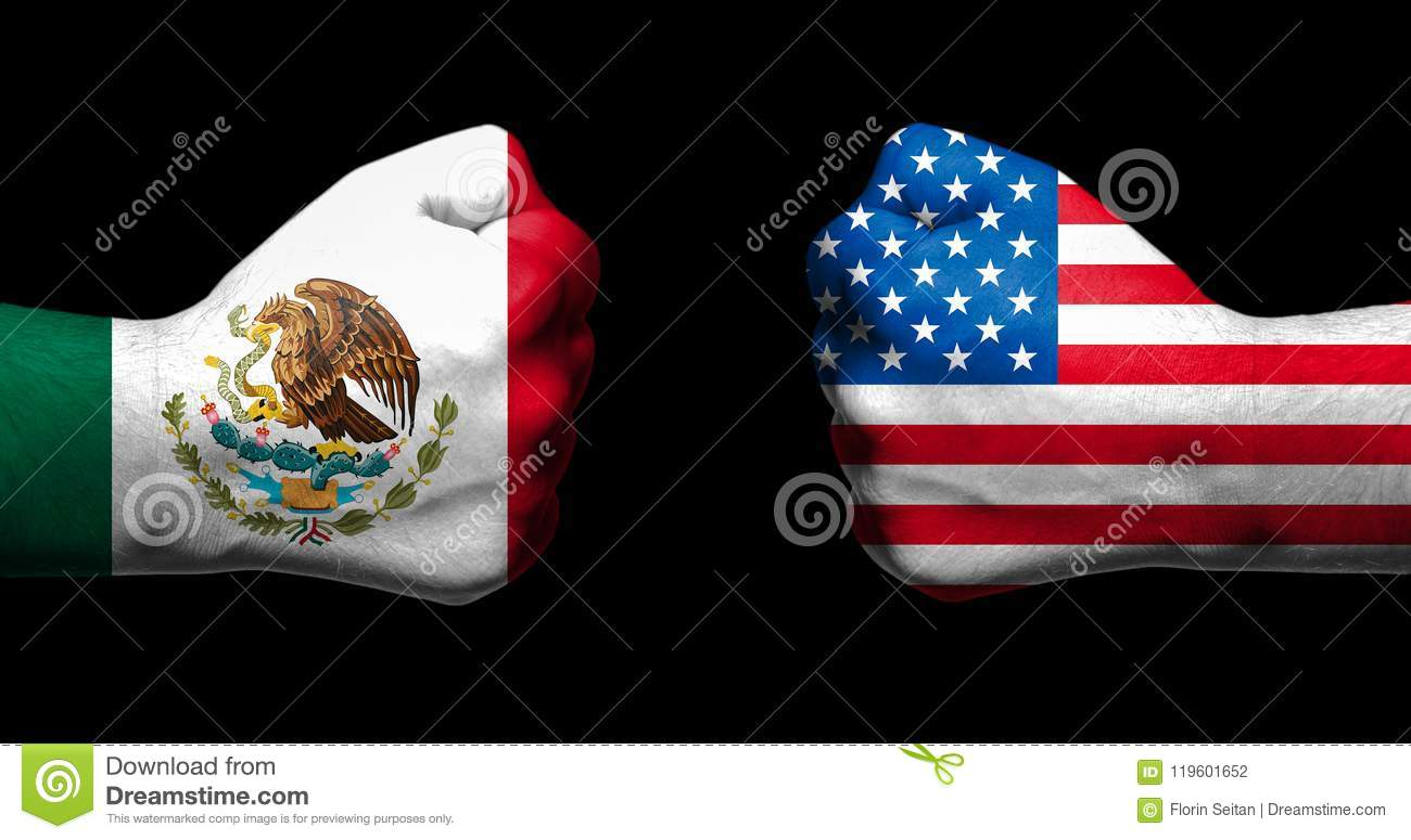 Flags of Mexico and United States painted on two clenched fists facing each other on black background/Mexico - USA relations conce