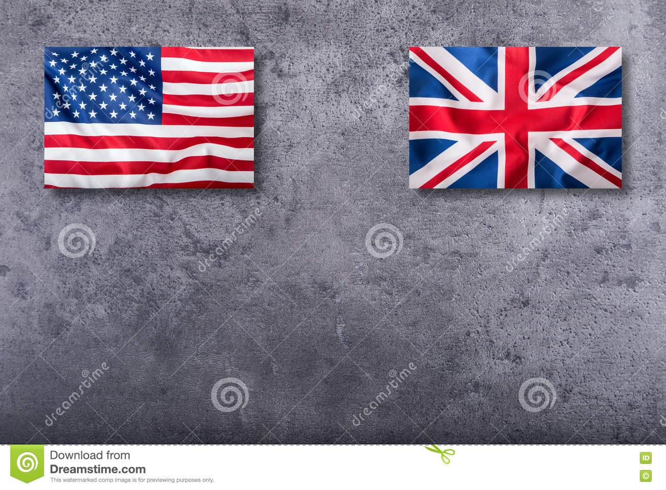 Flags of the USA and the UK. Union Jack flag on concrete background