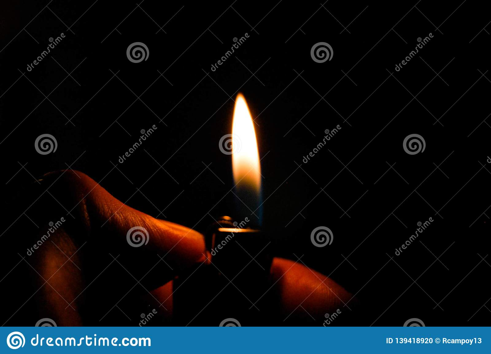 A flame in a dark room