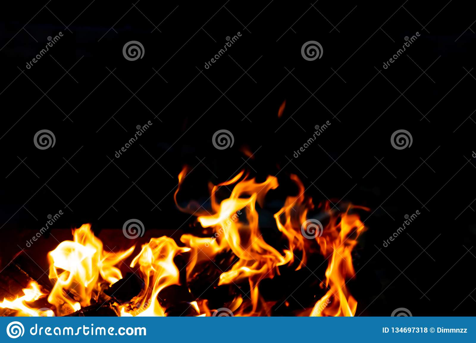 Flames Of Fire From Burning Coals In The Grill Late At Night  Stock
