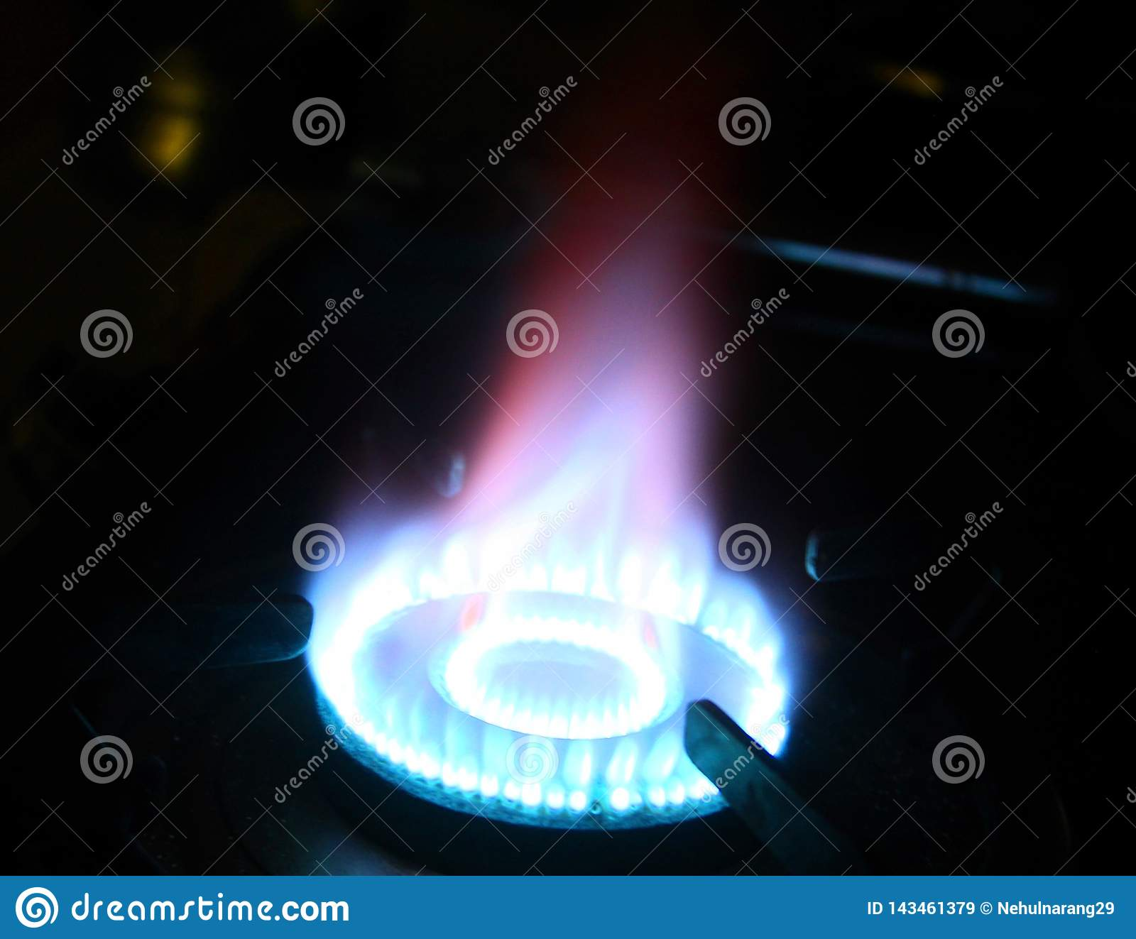 Flames on a gas stove in dark