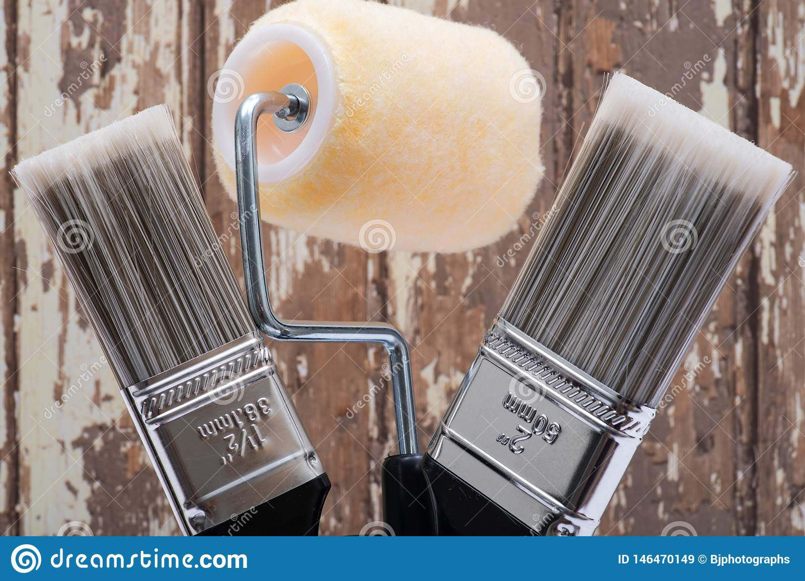 Flat Cut Utility Paint Brushes and High Density Knit Fabric Trim Roller with Frame  on wood