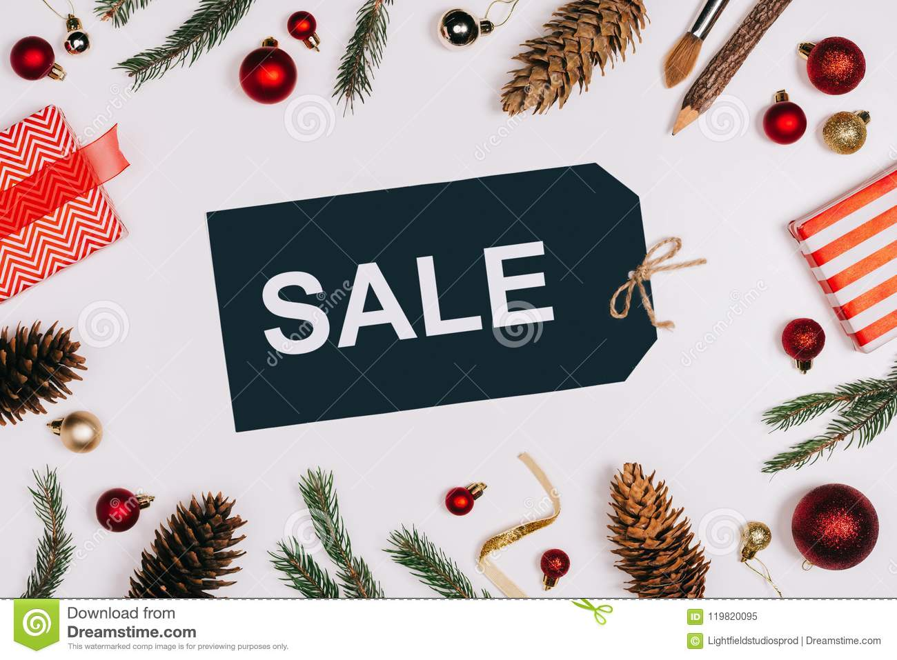Flat Lay With Arranged Price Tag With Sale Lettering, Pine Cones ...