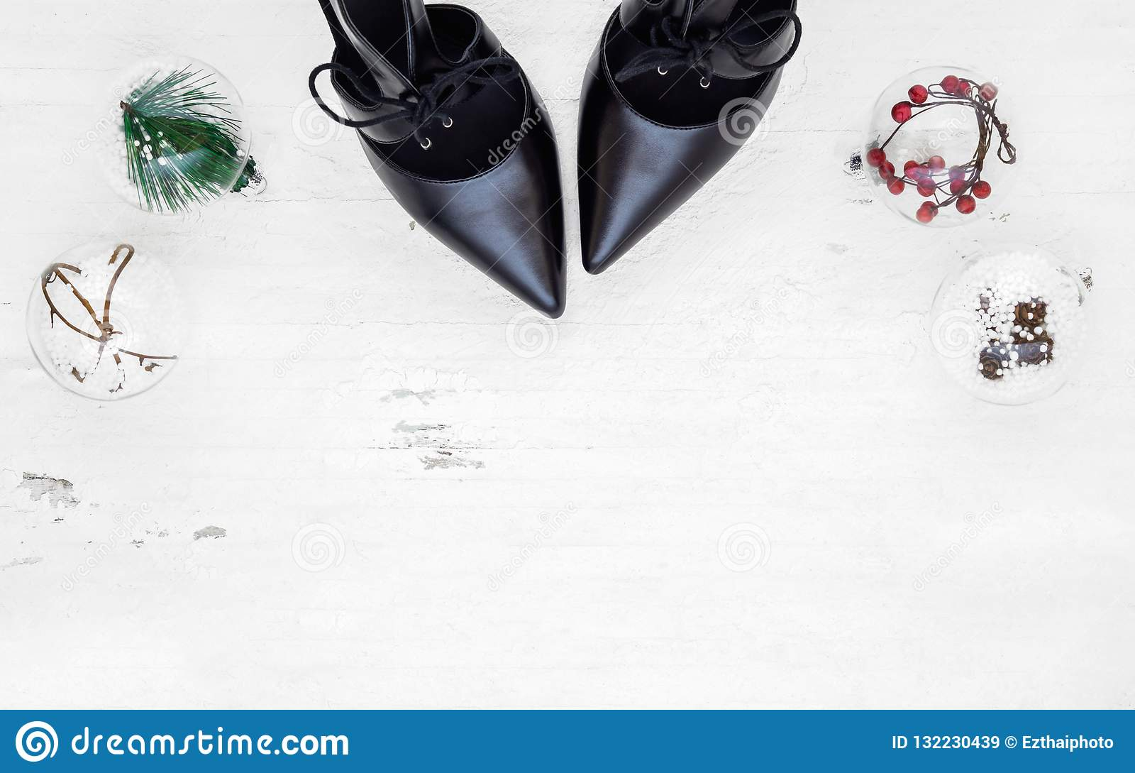 Flat Lay Black High Heel Shoes And Christmas Ornaments On Grunge