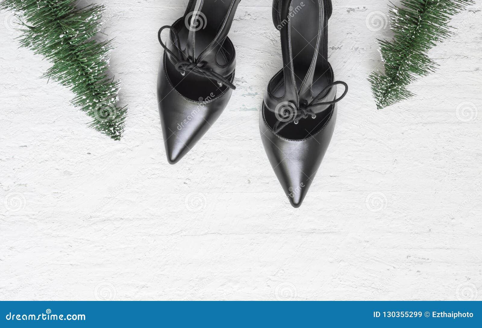 Flat Lay Black High Heel Shoes And Mini Christmas Tree On Grunge Stock Image Image Of Decoration Festive 130355299