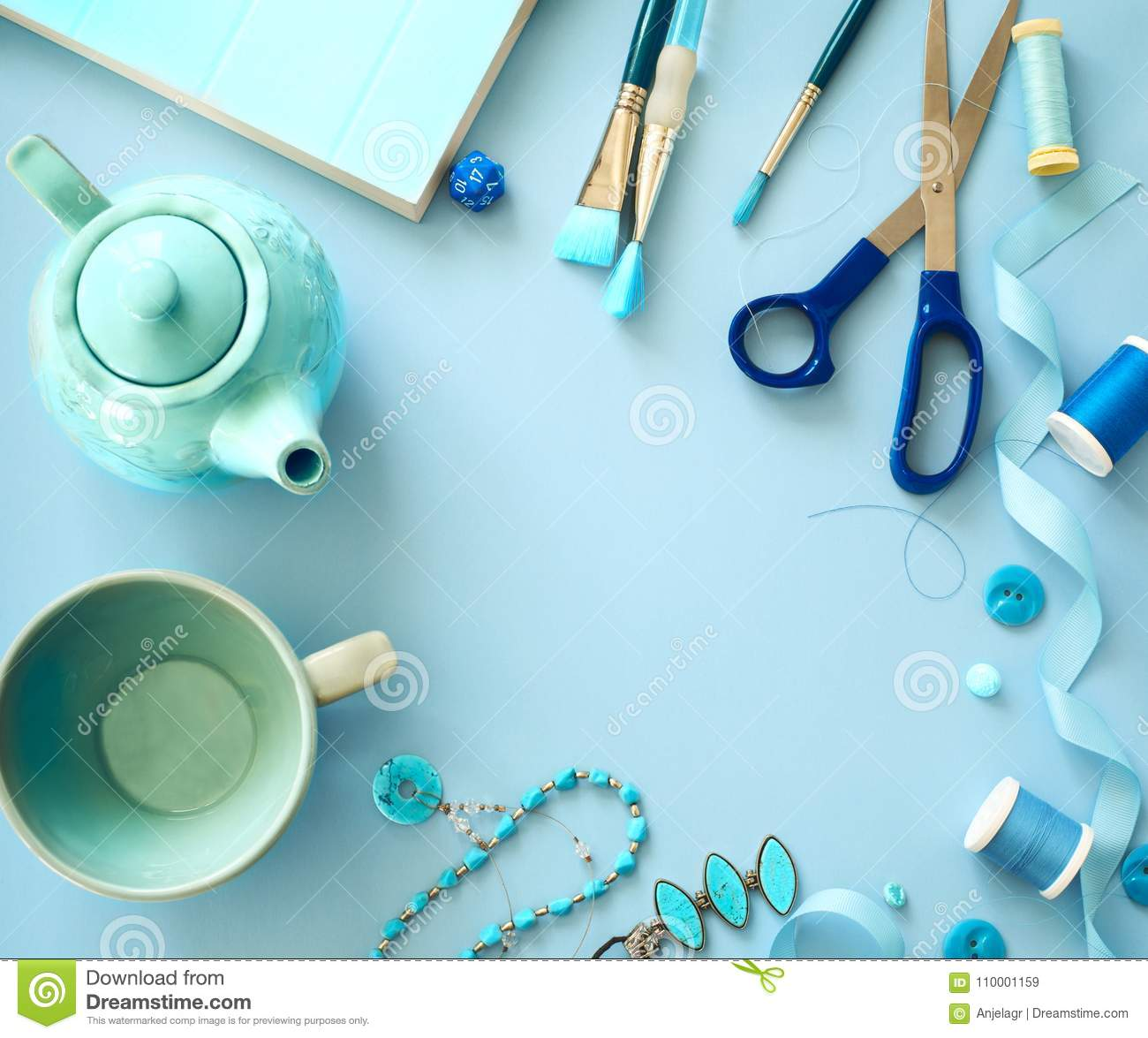 Flat Lay Blue Color Objects And Accessories Frame On Light Blue