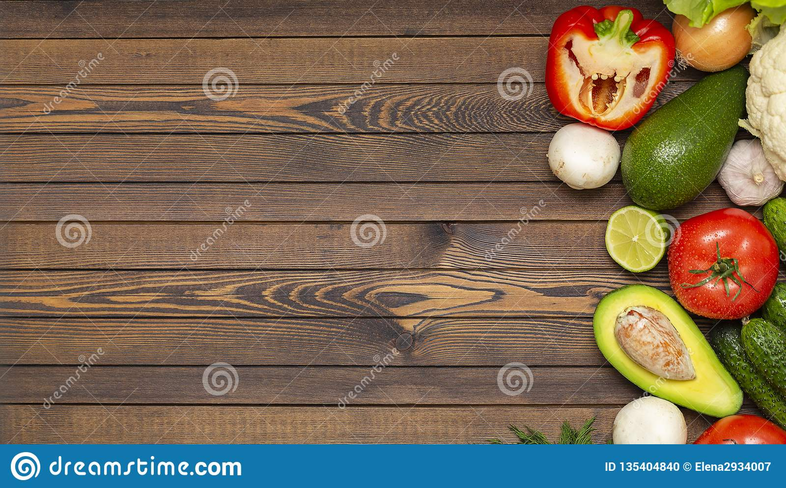 Flat lay composition with assortment of fresh vegetables on wooden table. Fresh farmers garden vegetables on wooden table.