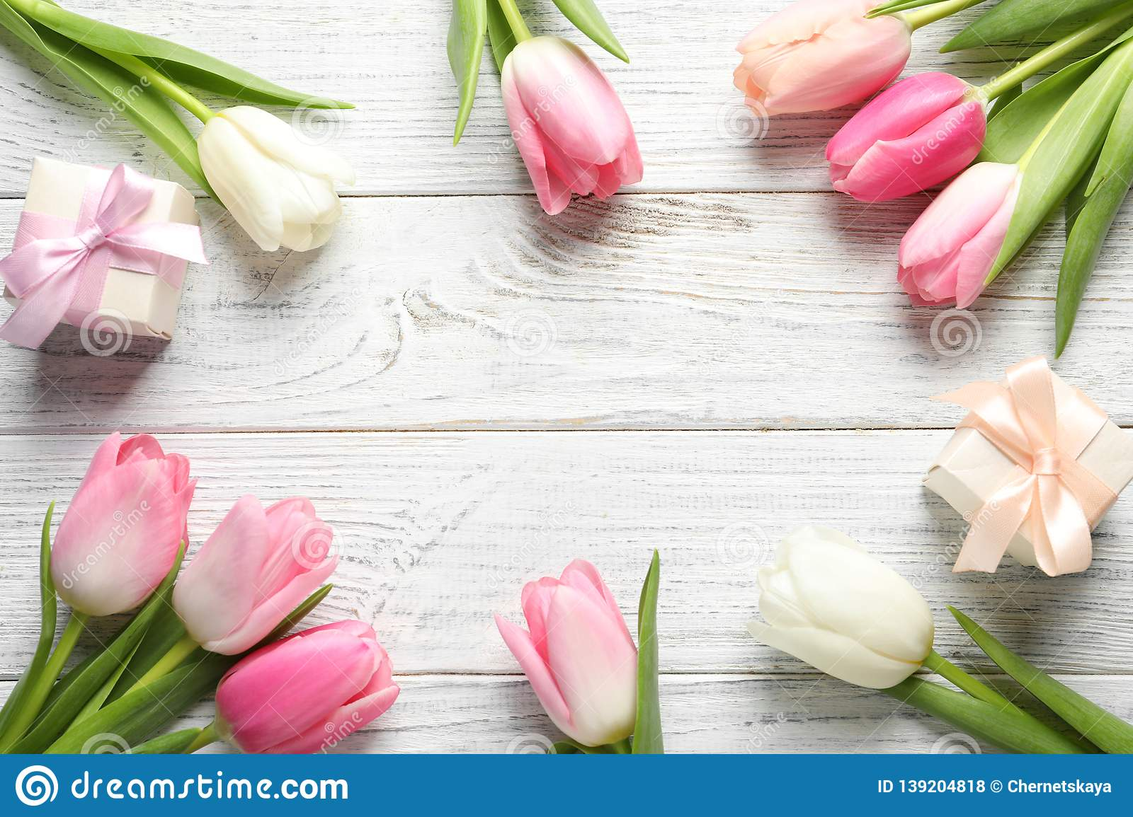 Flat lay composition of beautiful spring tulips on wooden background, space for text.