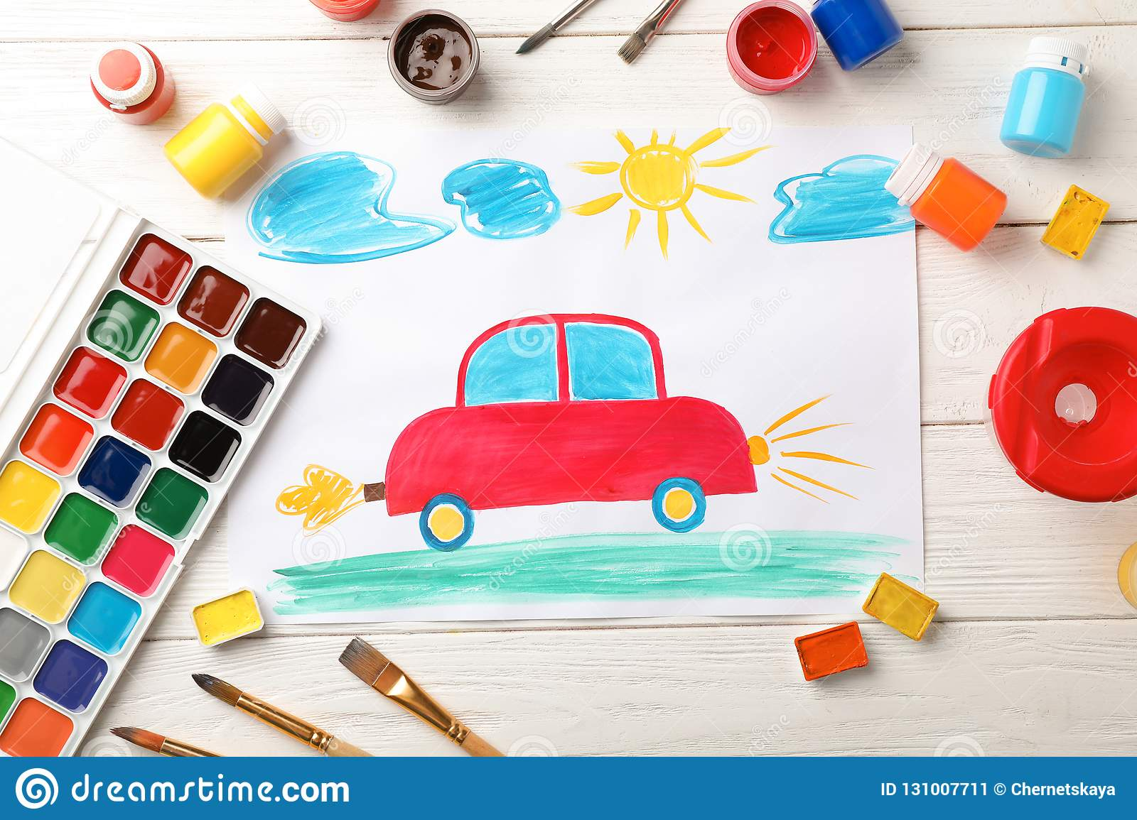 Flat lay composition with child`s painting of car