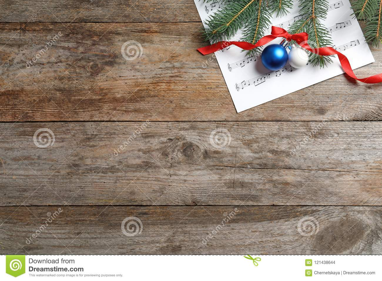 Flat lay composition with Christmas decorations and music sheet