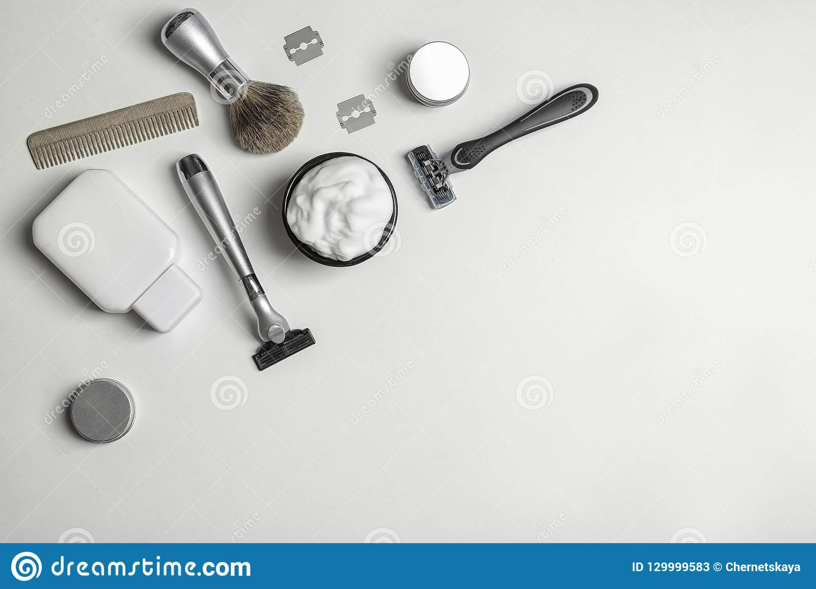Flat lay composition with men`s shaving accessories and space for text