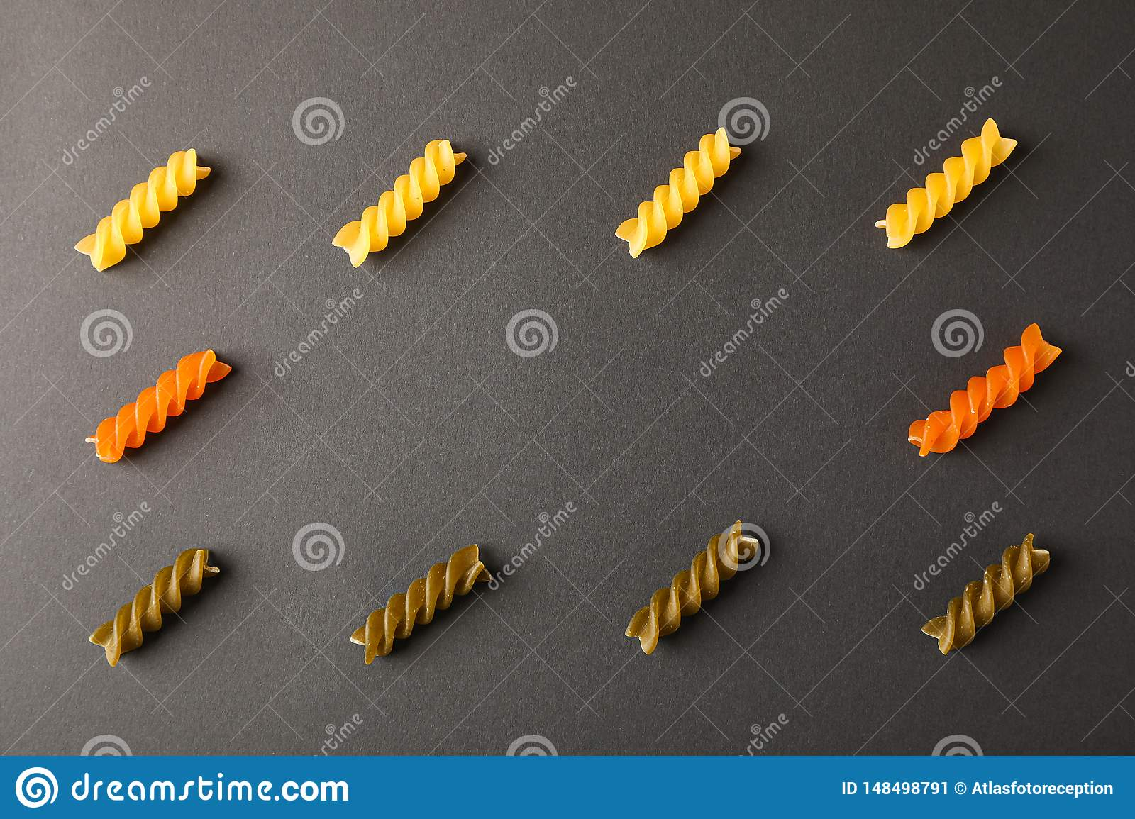 Flat lay composition with multicolored pasta on black background
