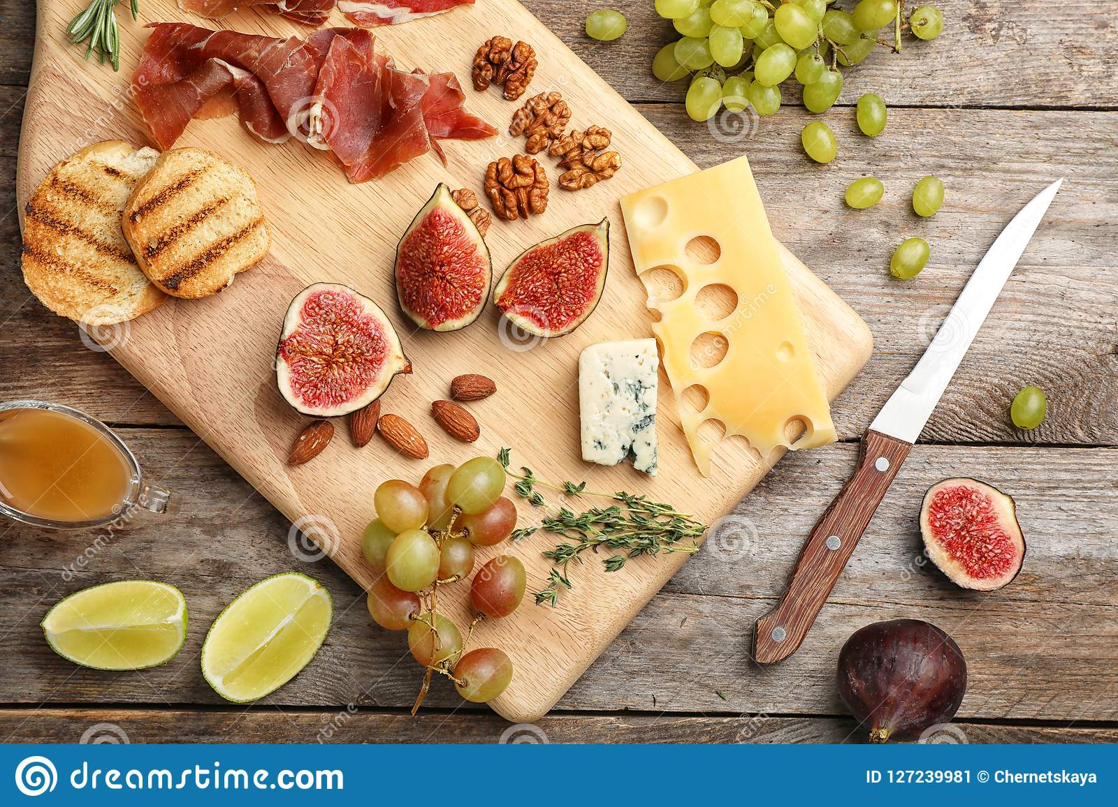 Flat lay composition with ripe figs and delicious products