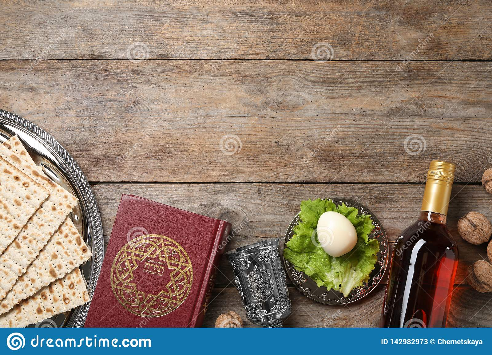 Flat lay composition with symbolic Passover Pesach items on wooden background