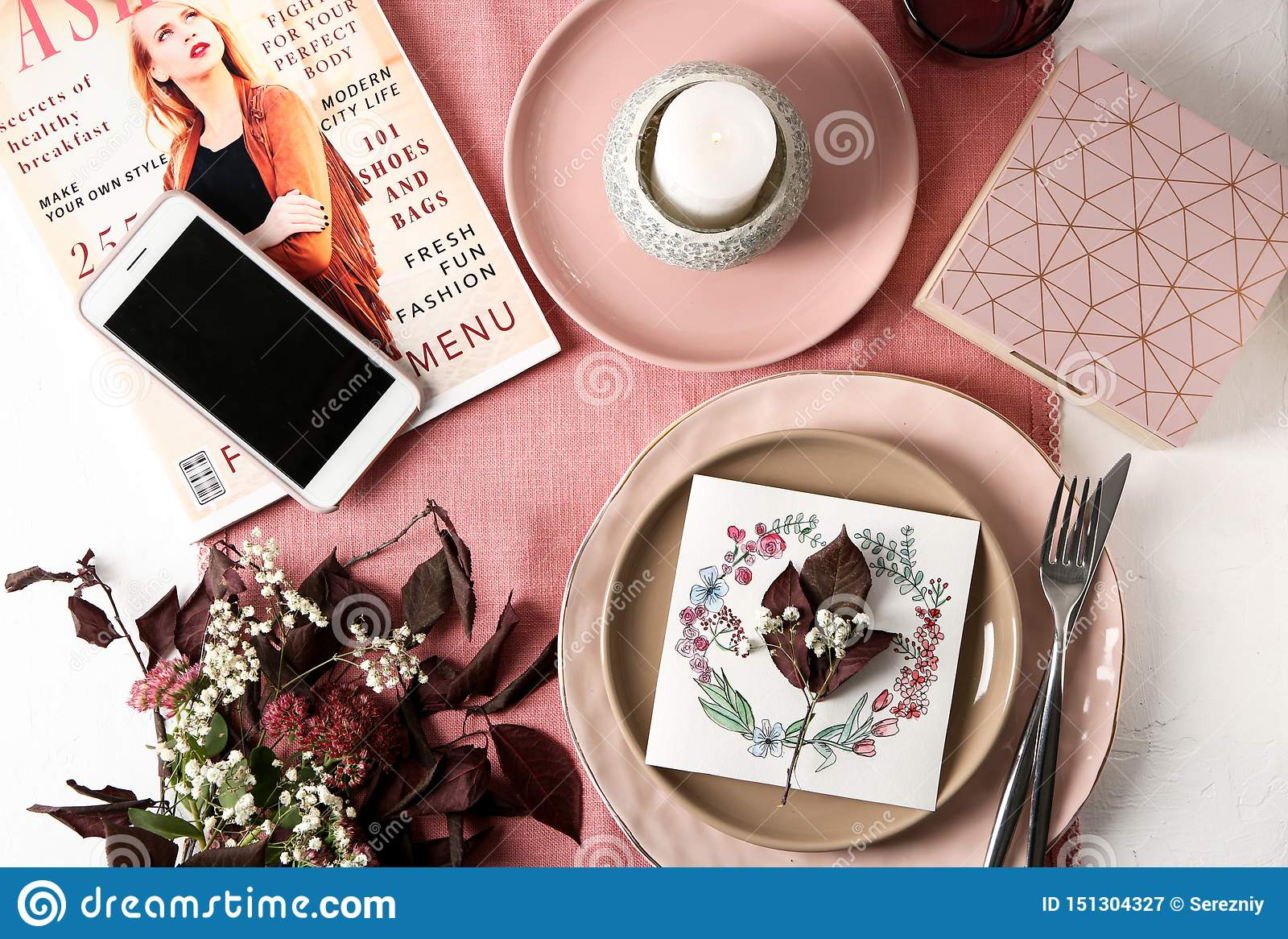 Flat Lay Composition With Tableware Mobile Phone Floral Decor