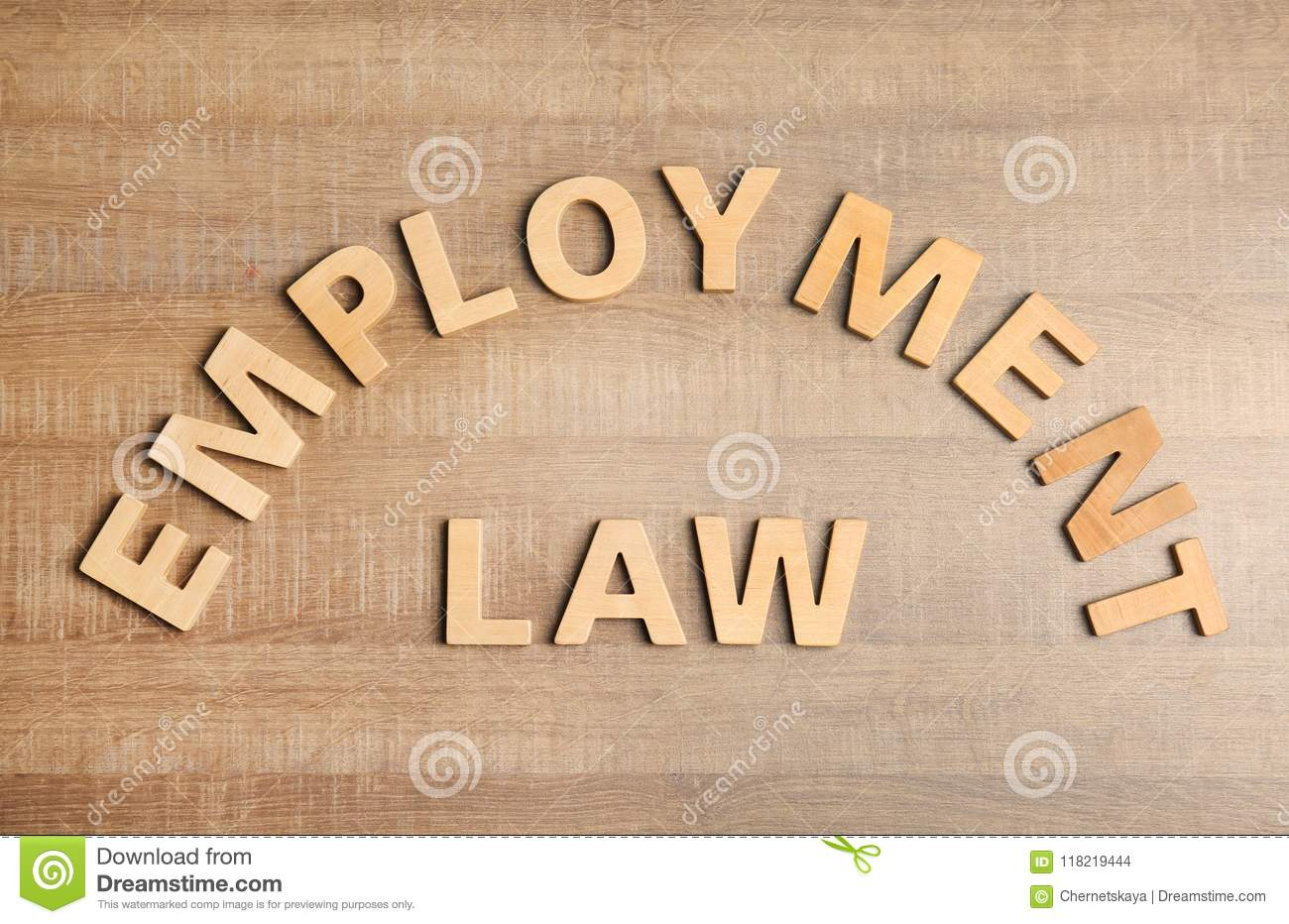 Flat lay composition with phrase EMPLOYMENT LAW on wooden background