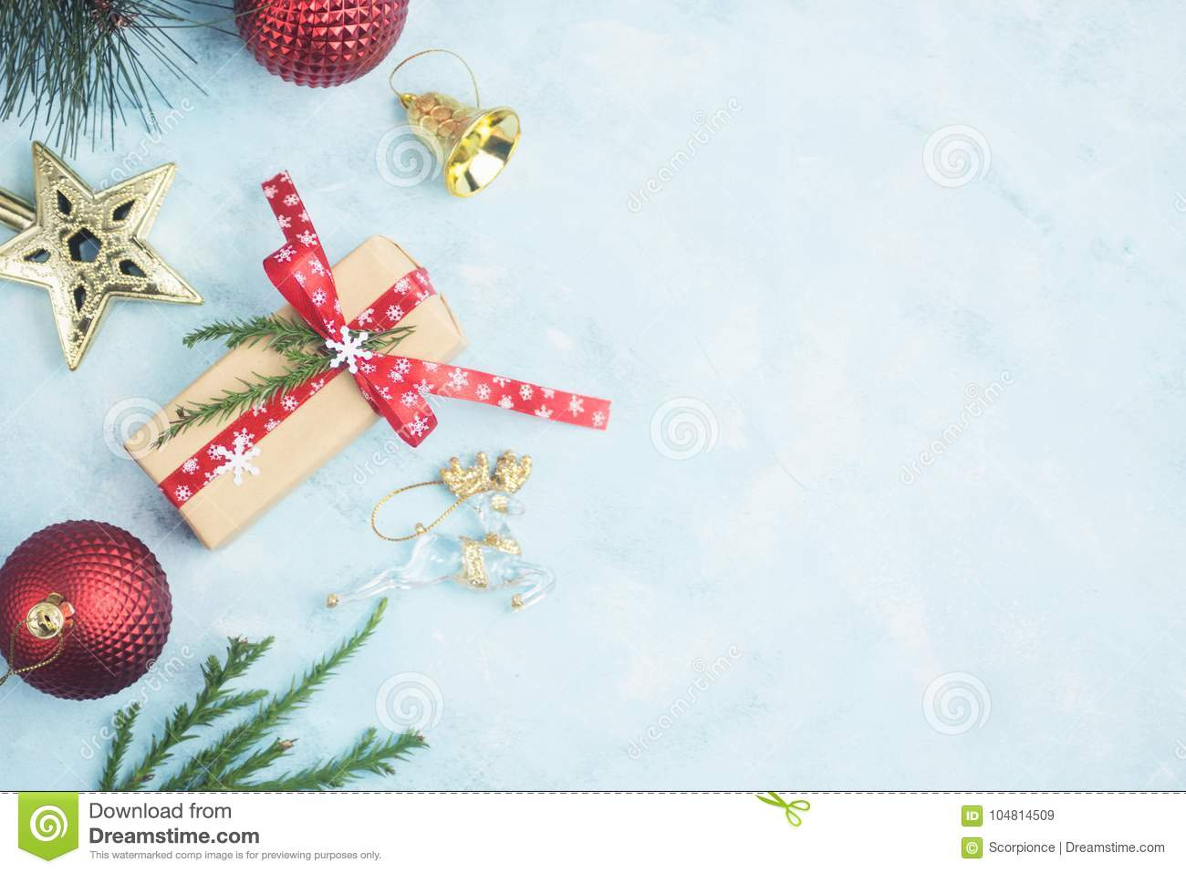 flat lay top view christmas gifts and gold stars with toys on blue table new year concept text space