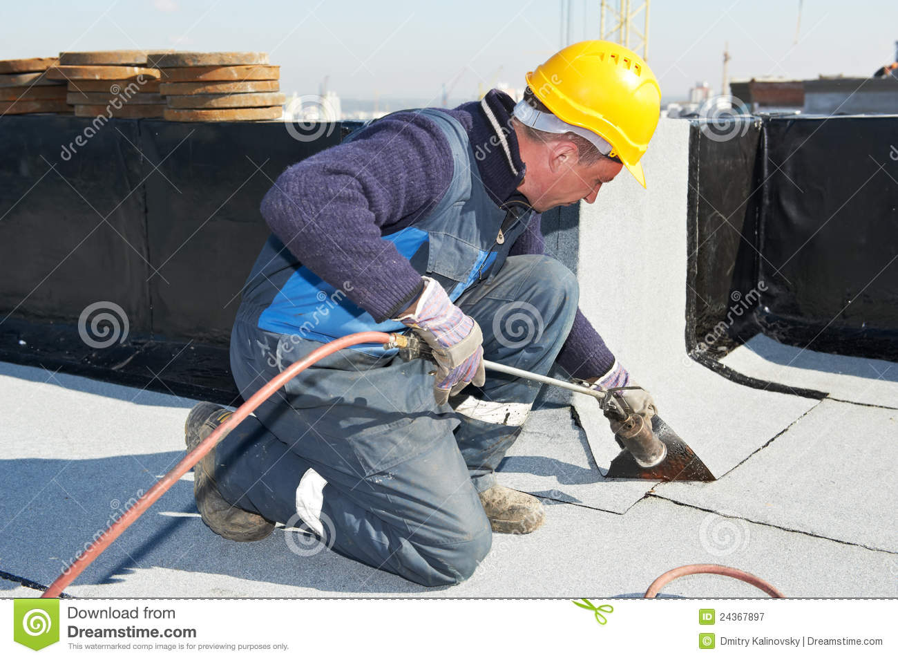 Flat Roof Covering Works With Roofing Felt Stock Image
