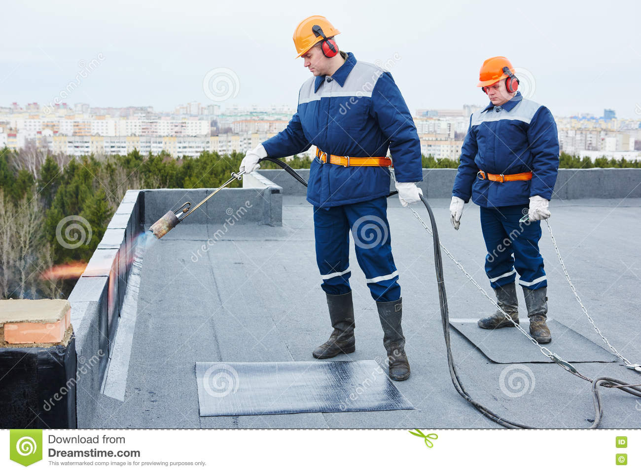 Flat Roof Installation Heating And Melting Bitumen