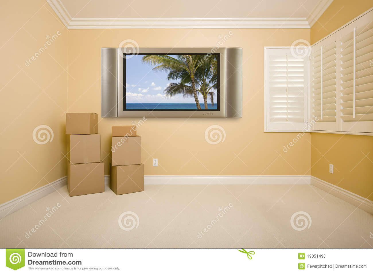 Flat Television On Wall In Empty Room With Boxes Stock