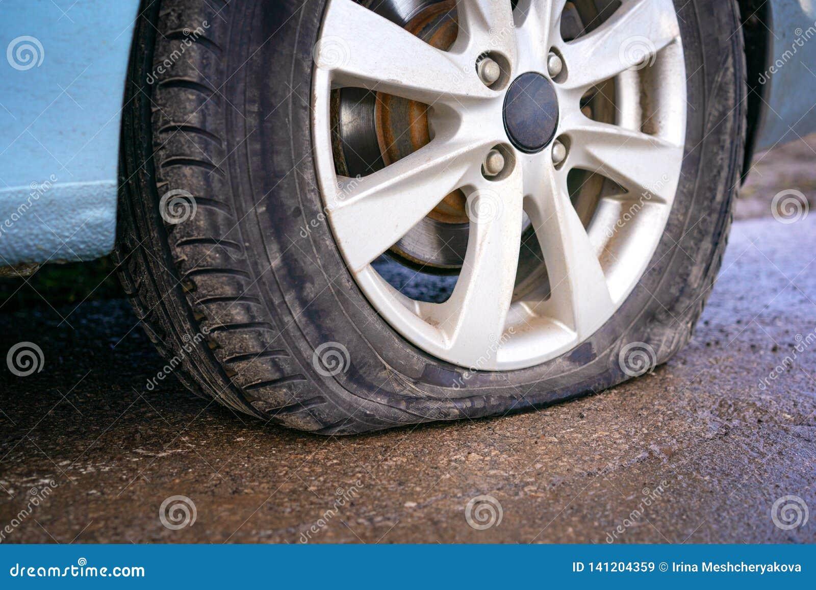 Nail In Tire Repair >> Flat Tire Of Blue Car On The Road Waiting For Repair Car Tire Leak