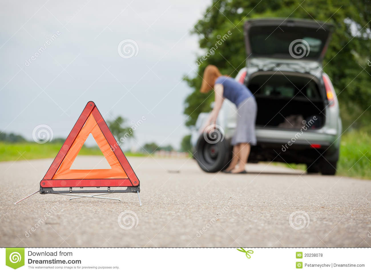 Flat tire on a car stock photo. Image of female, problems ...