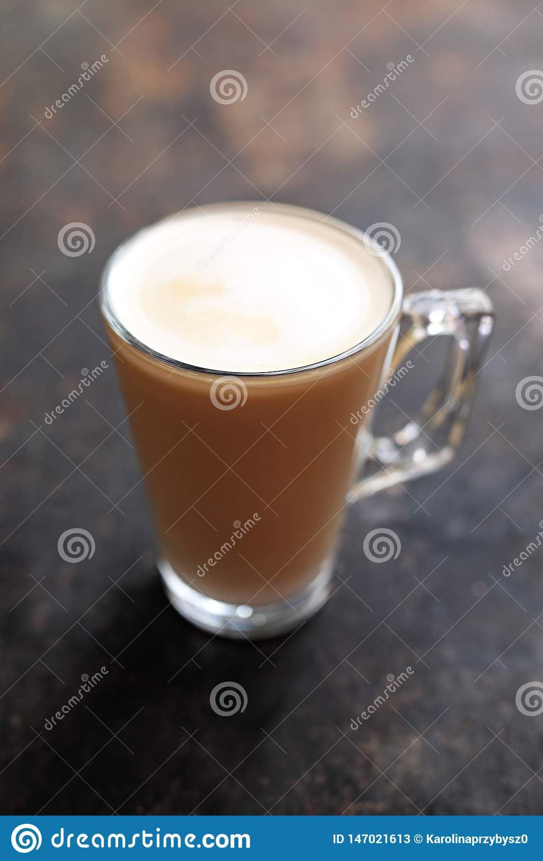 Flat white coffee with milk foam transparent glass cup