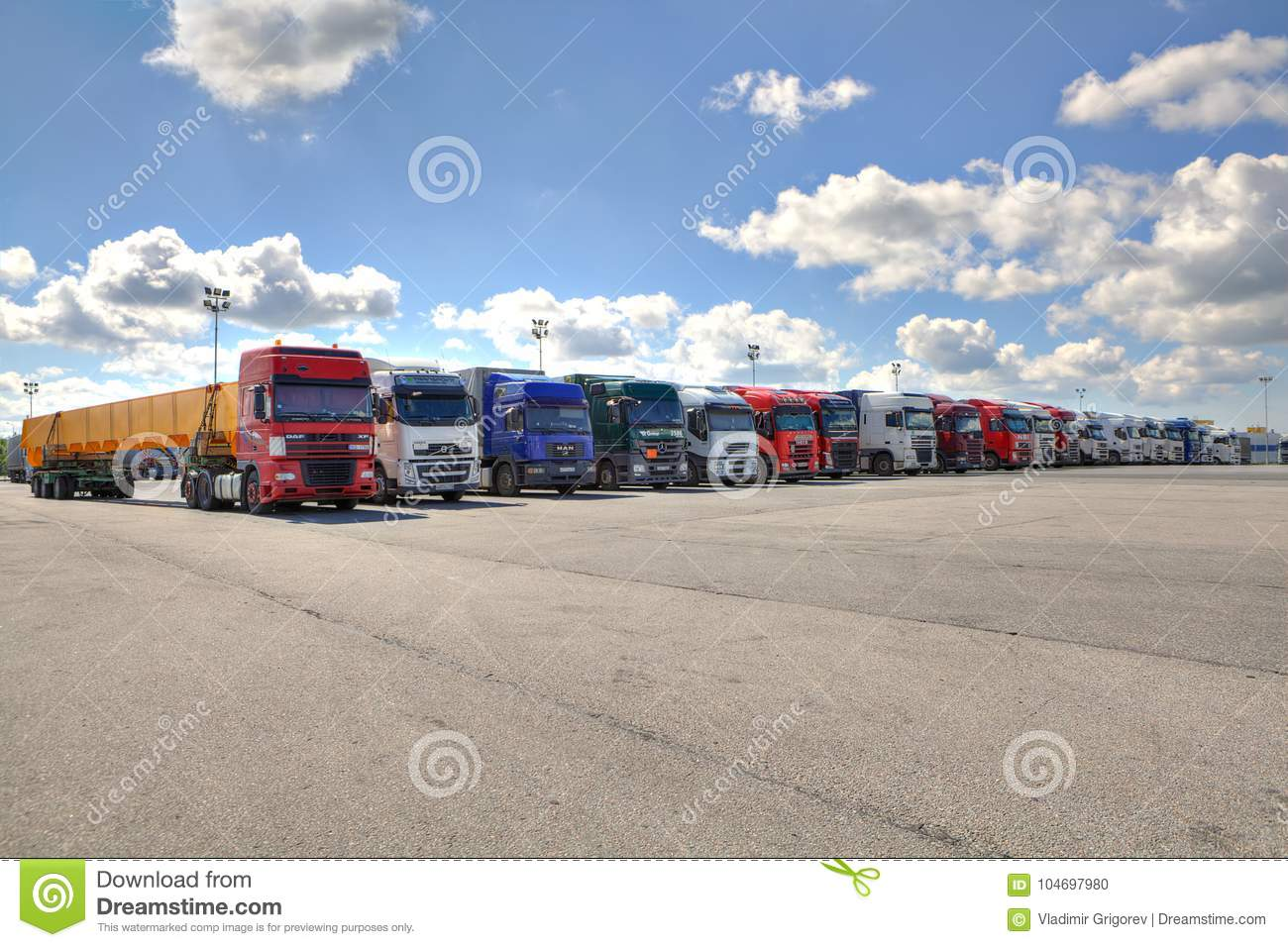 Fleet of lorries with trailer in courtyard of logistics terminal