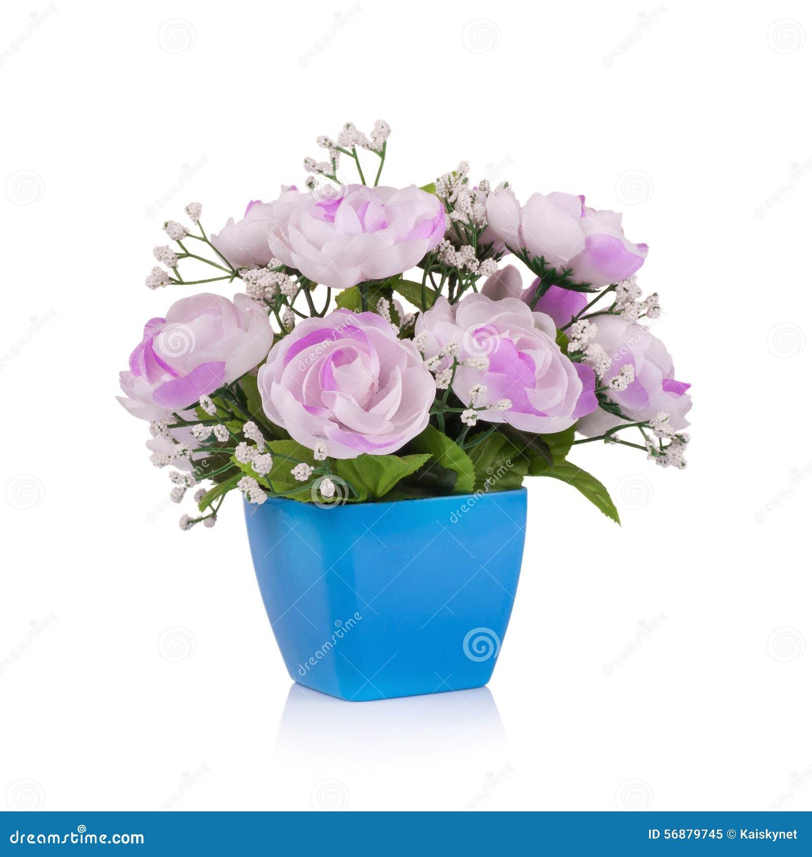 Fleur en plastique pour la décoration sur le fond blanc