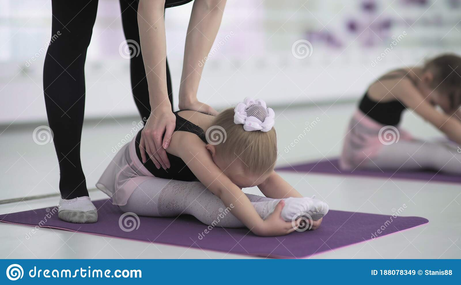 stock-photo-flexible-ballet-dancer-stretching-in-the-dark