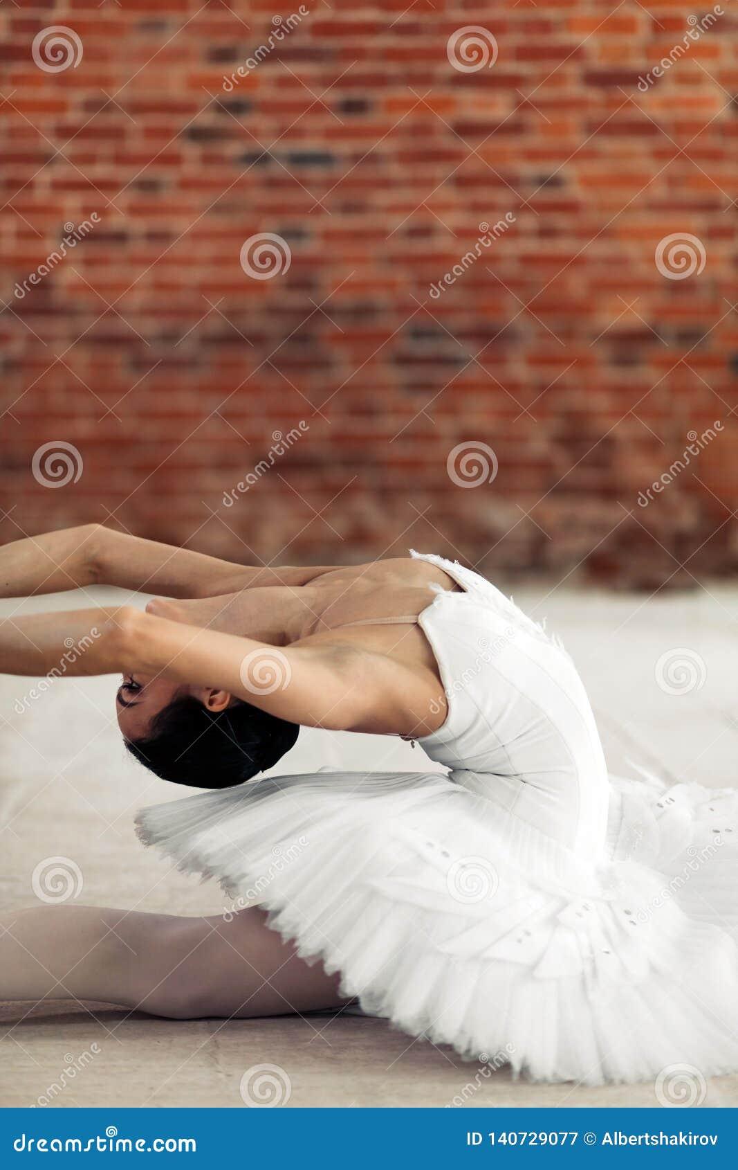 Flexible Young Ballerina Doing Vertical Split Stock Photo