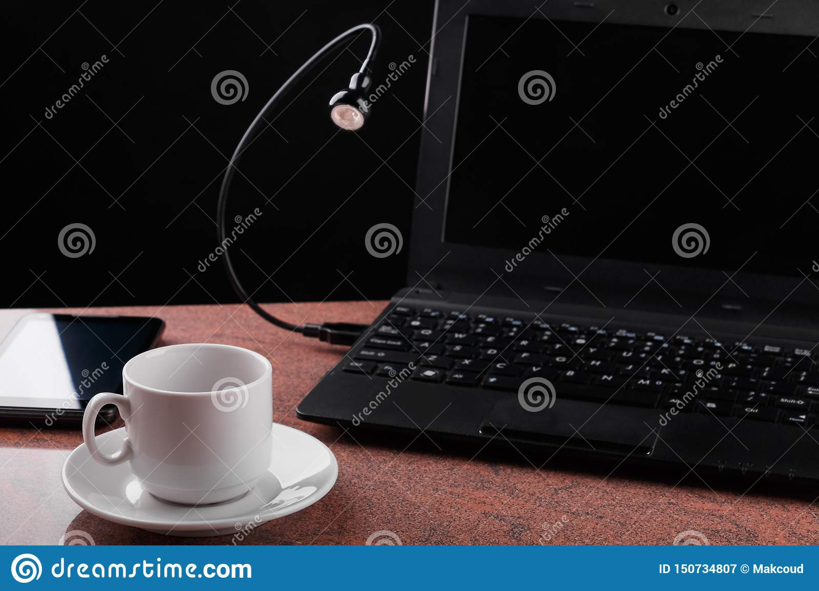 Led Usb Lamp Connected To Laptop And Looking At Coffee Cup