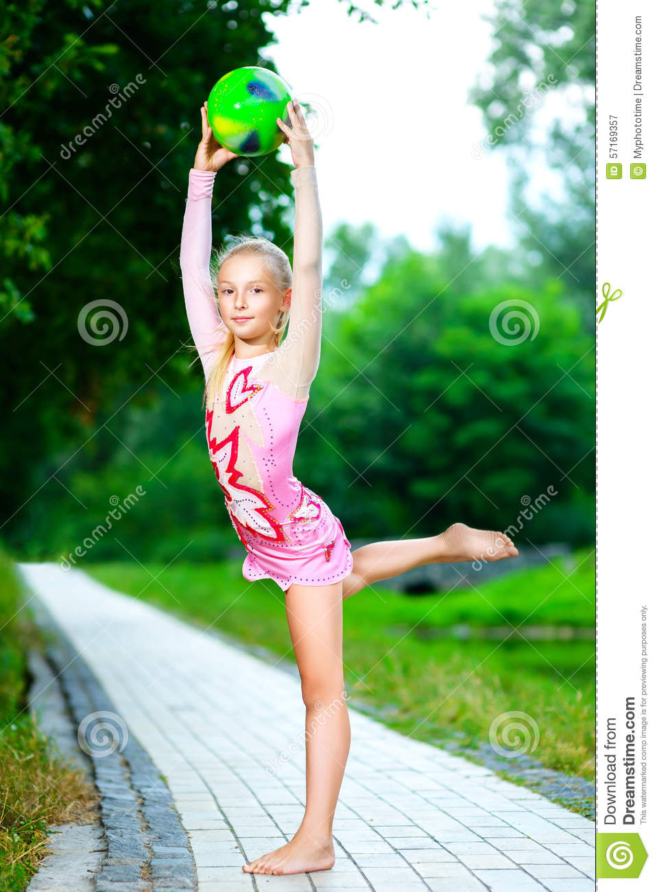 Flexible Little Girl Doing Gymnastics Vertical Stock Photo