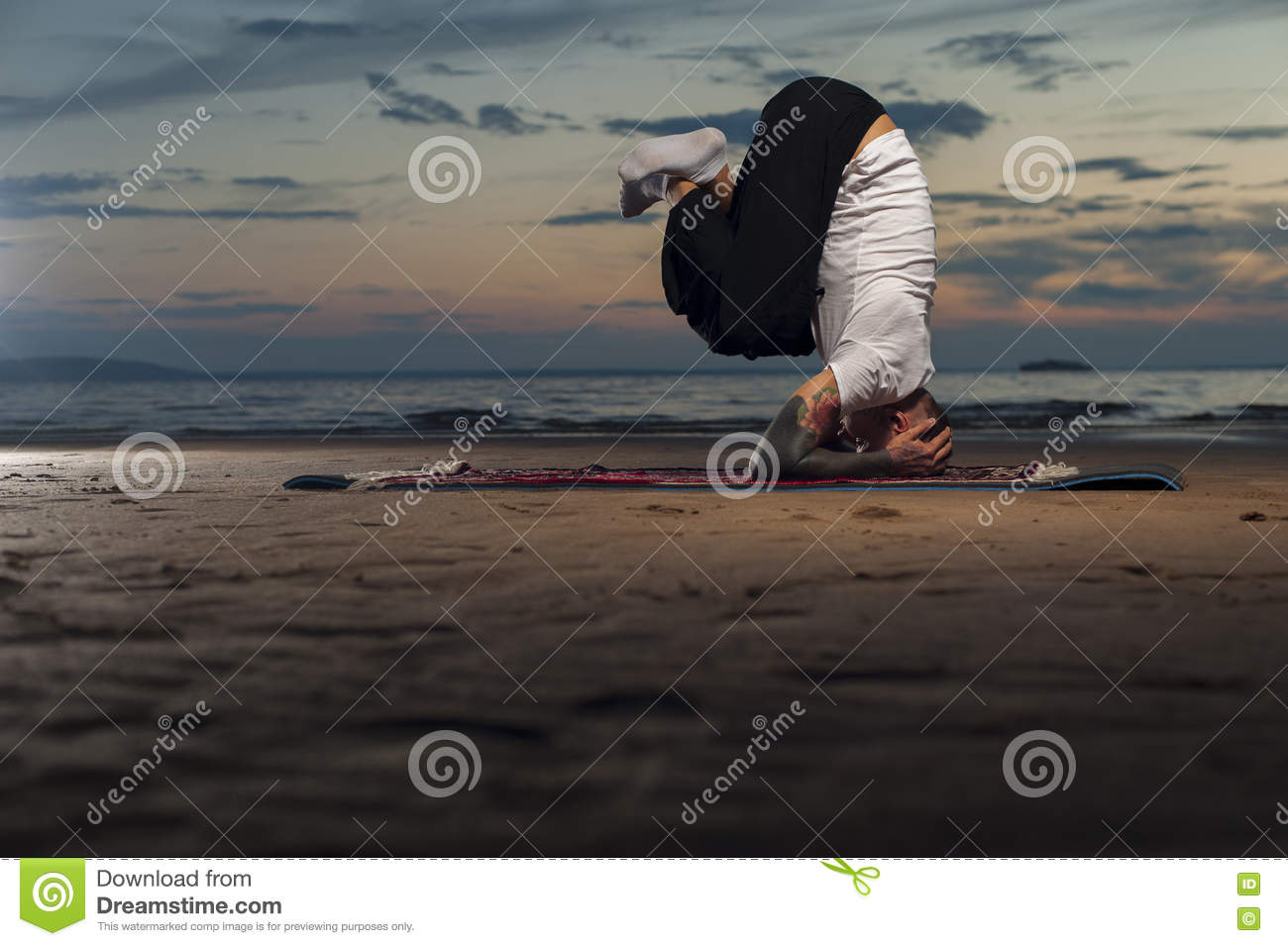 flexible yoga man doing head stand on the beach stock image image