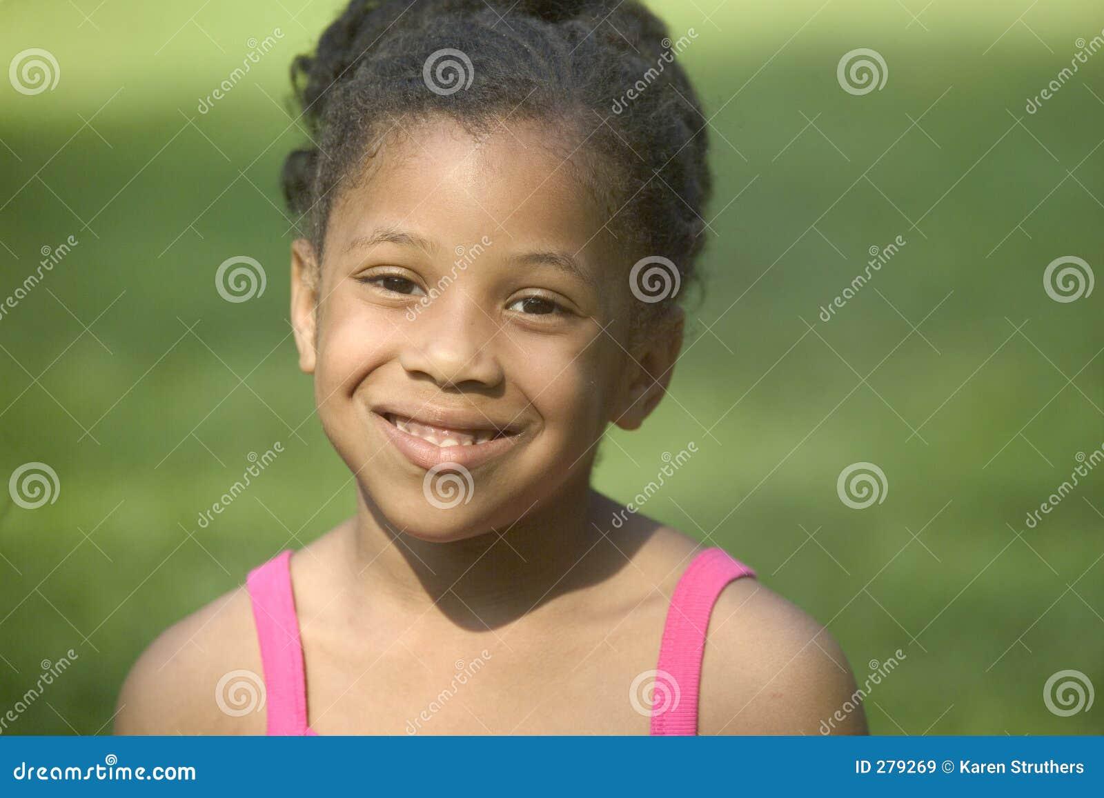 Flicka little leende