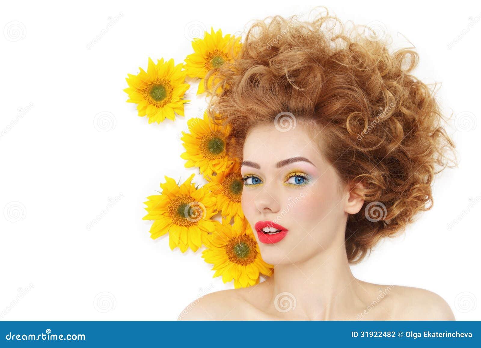 Flicka med solrosor