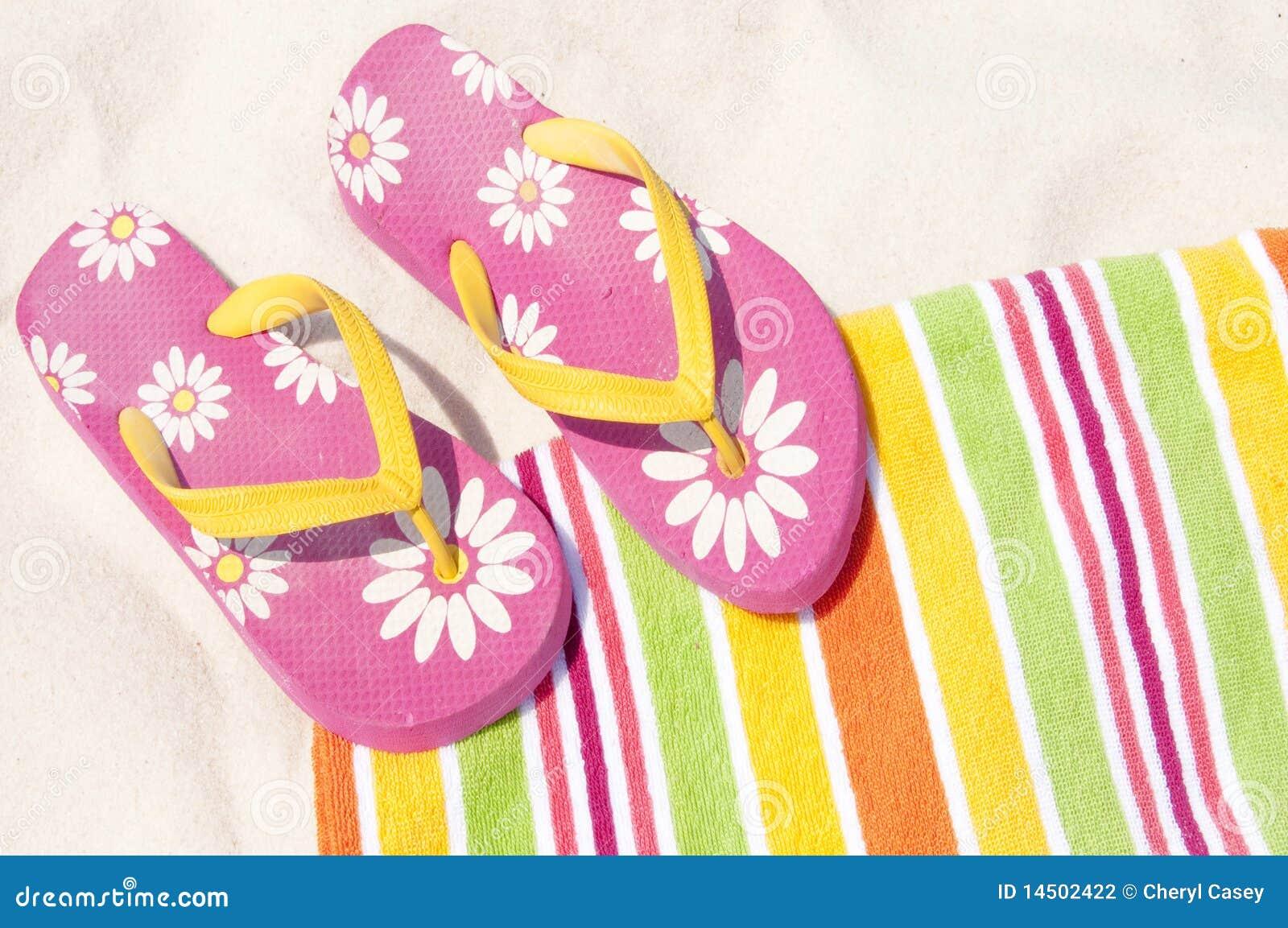 Flip flops on beach towel