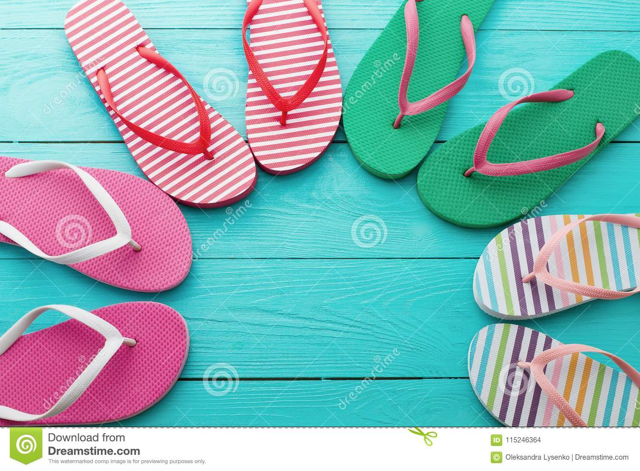 e1421456f Royalty-Free Stock Photo. Flip flops on blue wooden floor background. Top  view and copy space. Summer fun